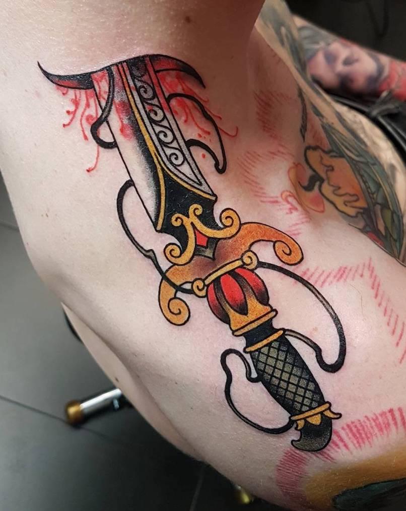 Victor Kludge dagger tattoo