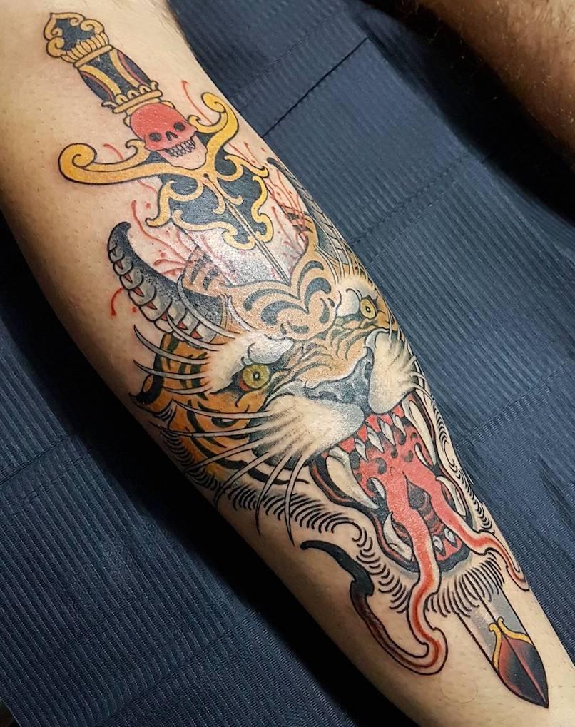 Victor Kludge tiger tattoo