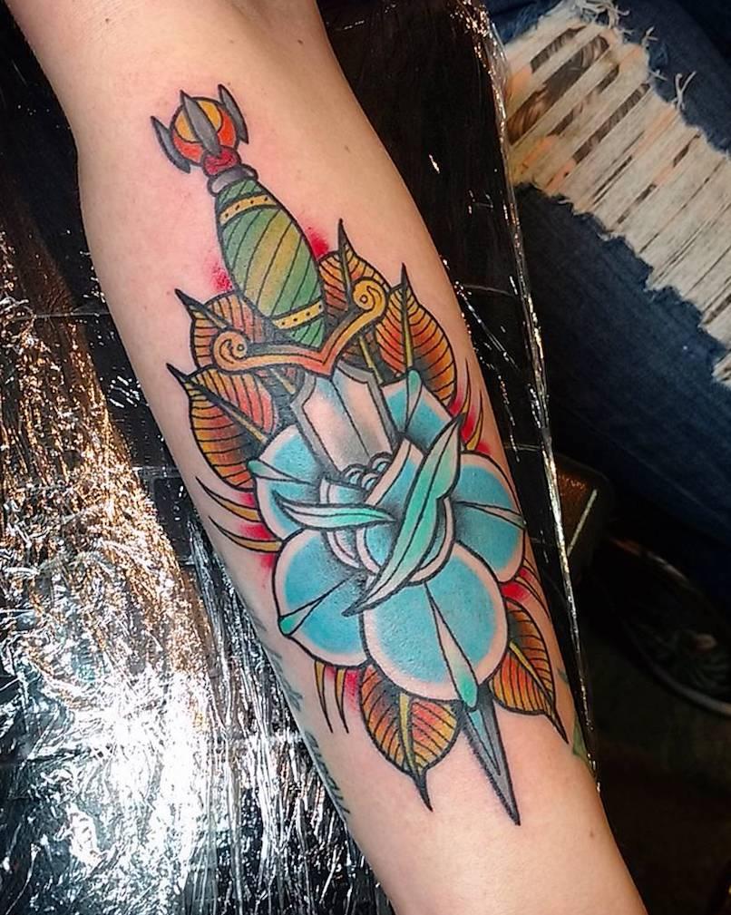 dagger in rose tattoo by Michael Kemp
