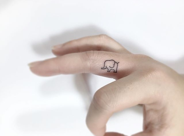 Finger Elephant Tattoo by Playground Tattoo