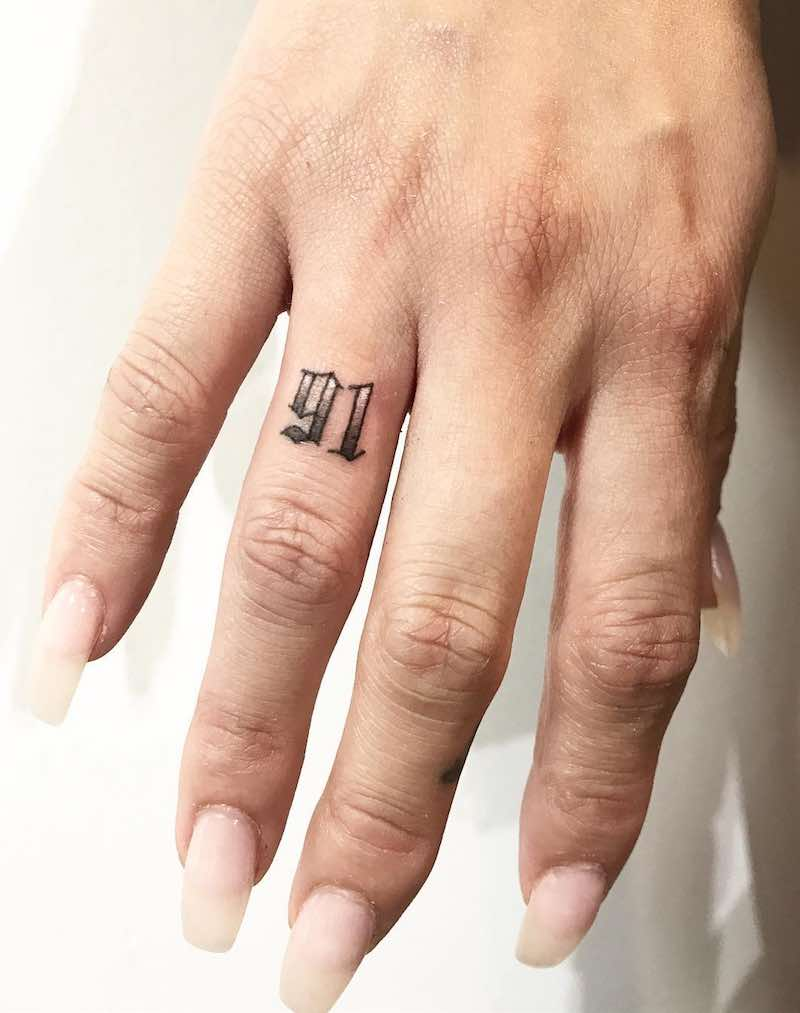 91 Finger Tattoo by JOJO