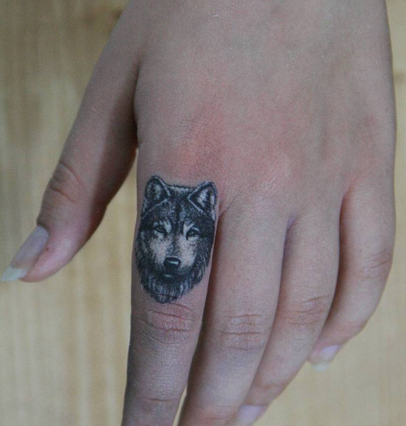 Wolf Finger Tattoo by Melek Tastekin