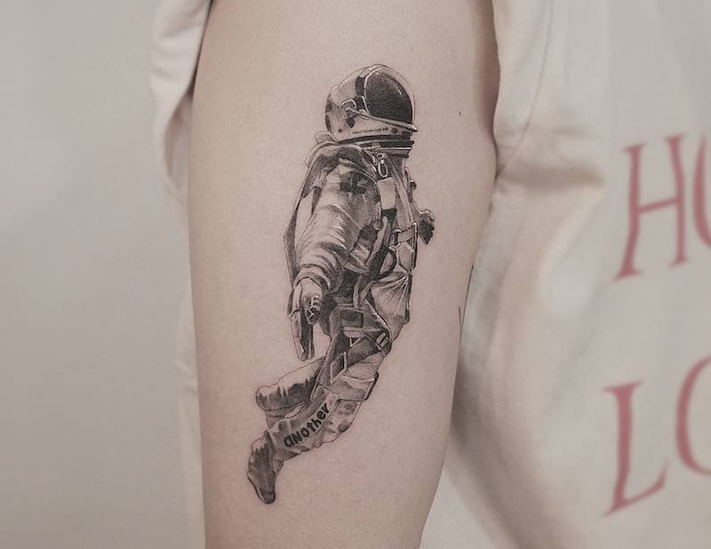 26 Out of this World Astronaut Tattoos