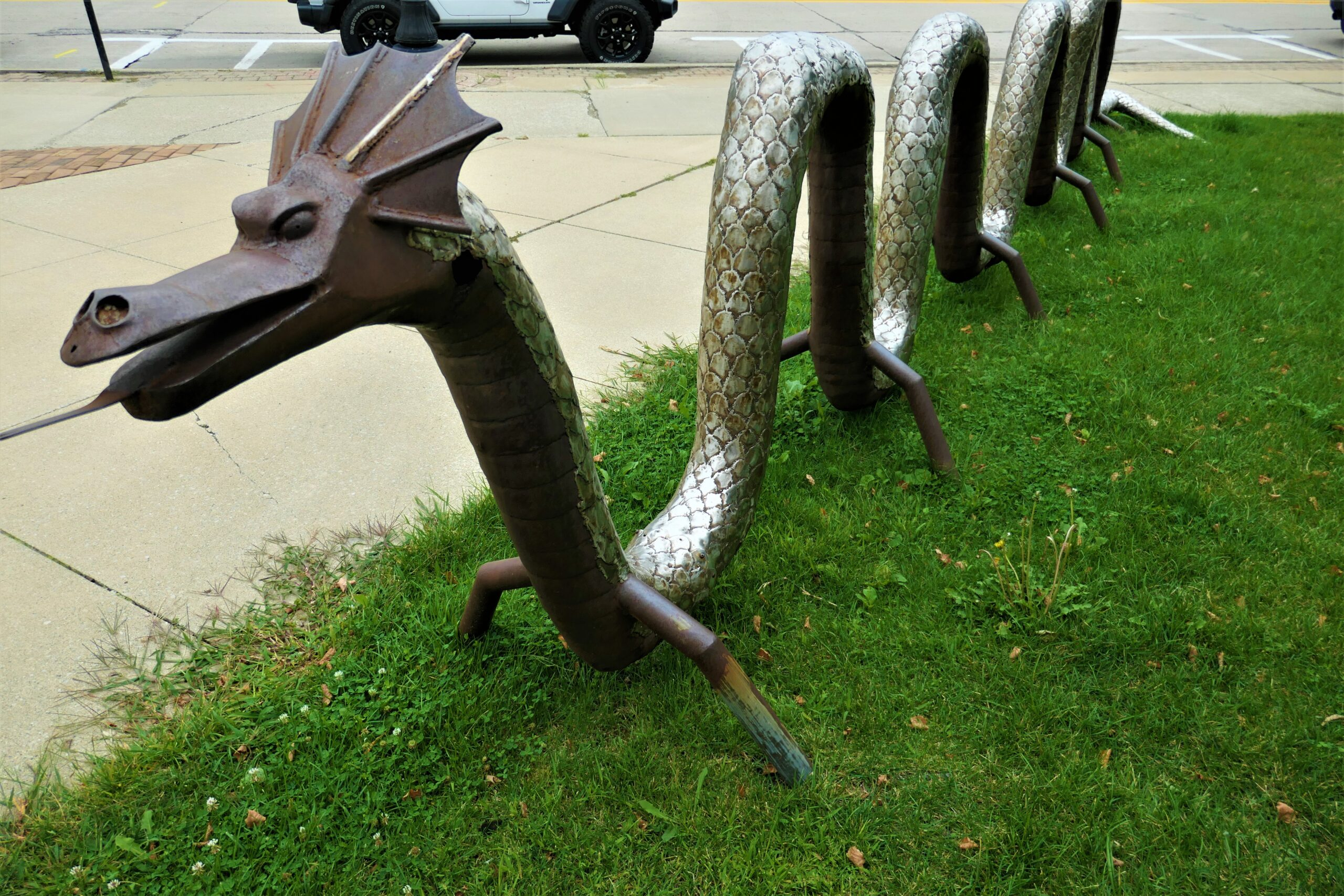 Photo of a sculpture of a twisty sea serpent with its tongue sticking out