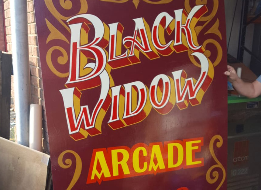 Black Widow Arcade Sign