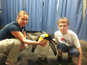 Katy Wozniak and Gavin with a King Penguin at the Pittsburgh Zoo
