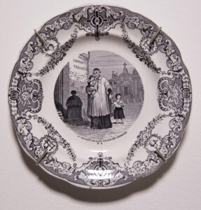Transferware in blue/black ink, opaque porcelain decorative plate; fourth in series 8 x 8 in.