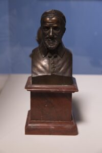 Cast bronze bust on red marble base 10 1/2 x 4 1/2 x 3 3/4 in.