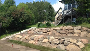 peterson-excavating-and-landscaping-duluth-minnesota-two-tiered-retaining-wall-using-large-boulders-300