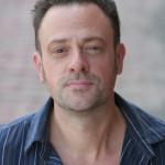Shaun Michael Morse as Scrooge