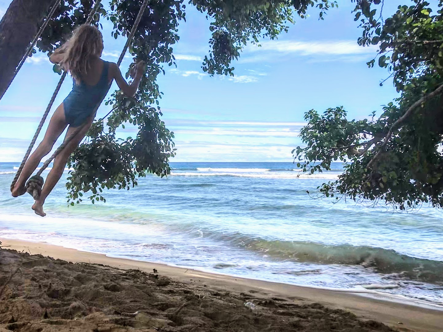 Young Girl Swinging At Swing Beach