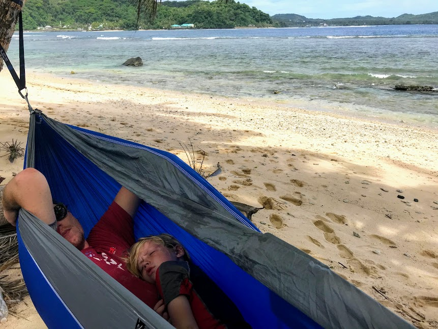 Nate and Holden napping in a beach hammock