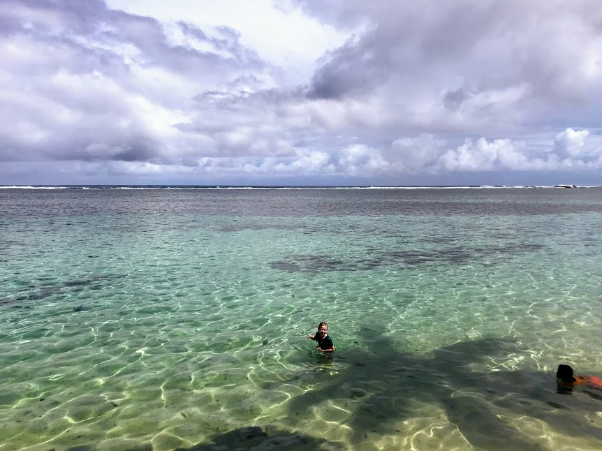 Children playing in the ocean during cyclone season in American Samoa