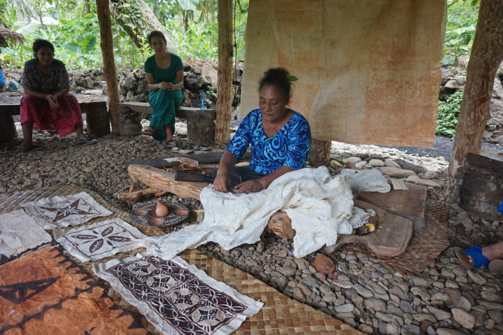 Woman creating traditional siapo