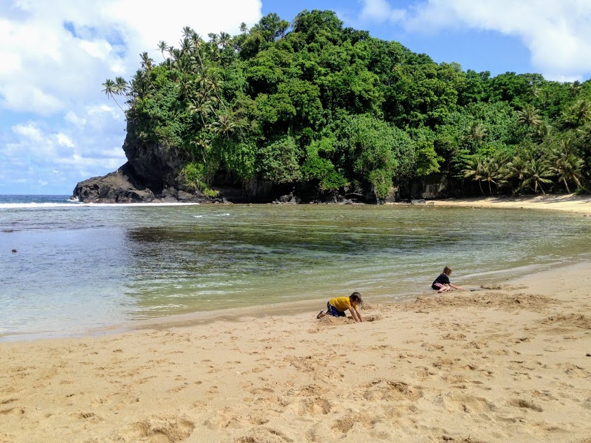 Young boys playing in the sand at Fogama'a