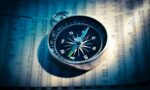 shallow focus photograph of black and gray compass