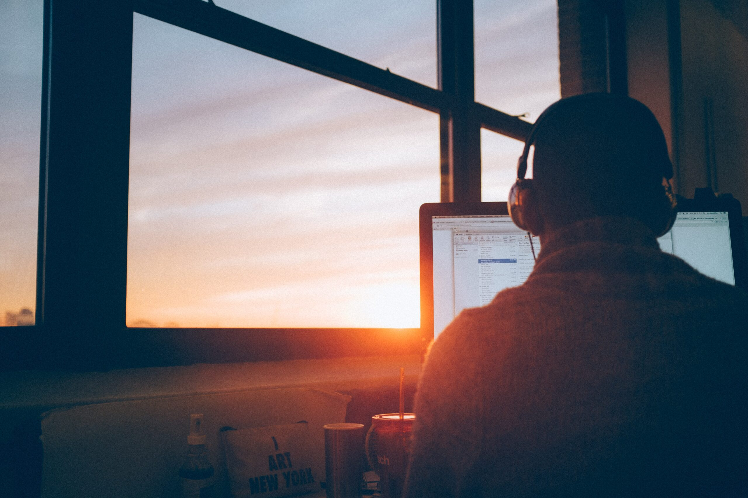 man sitting facing monitor