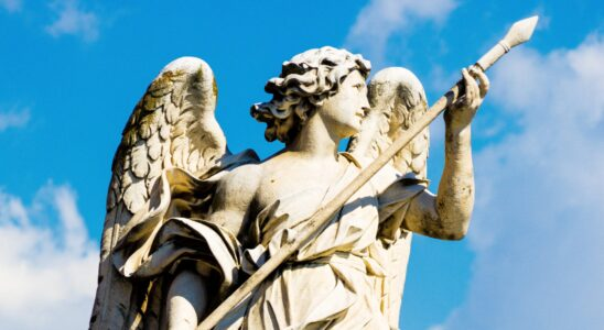 angel holding a stick statue