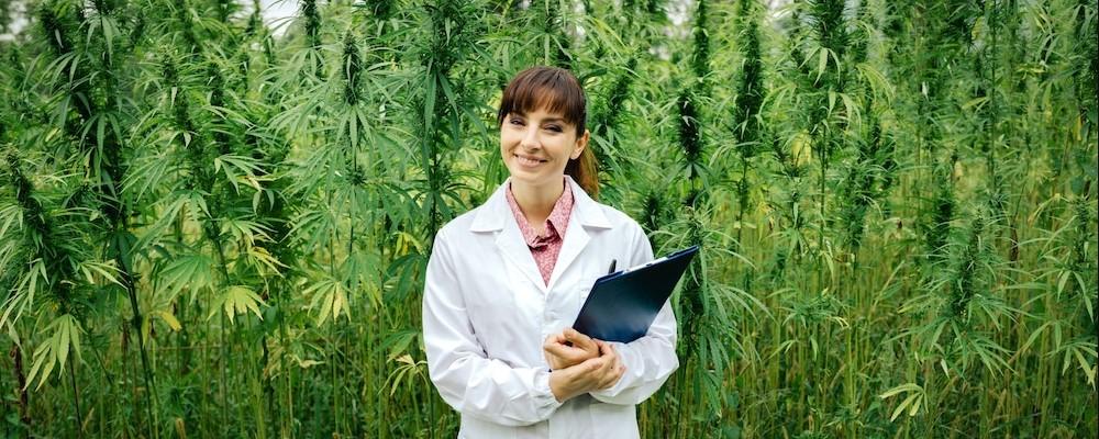autoflower-grower-standing-in-field-assessing-yields