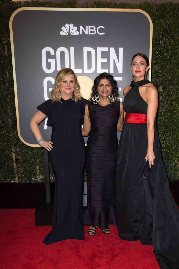 Amy Poehler, Saru Jayaraman and Mandy Moore arrive at the 75th Annual Golden Globe Awards Red Carpet