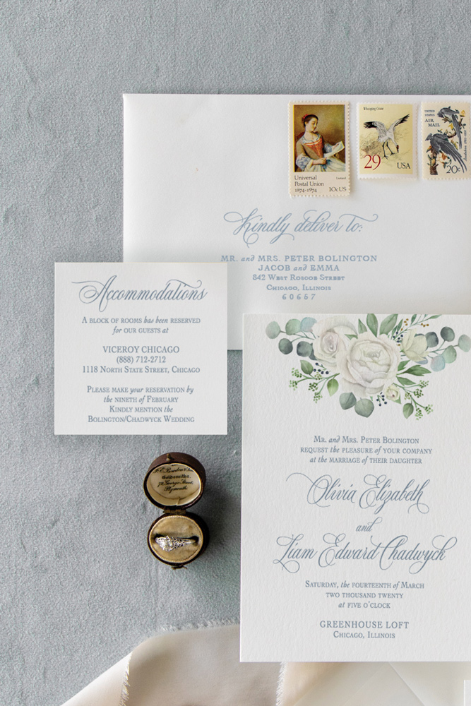 Guest envelope addressing in dusty blue for Chicago wedding invitation suite at the Greenhouse Loft.