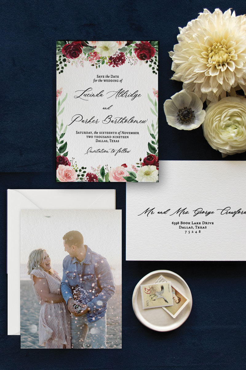 Watercolor save the date with burgundy, blush, and white flowers and elegant calligraphy script font and engagement photo.