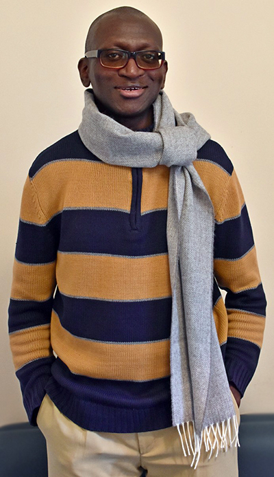 Man wearing a sweater and wool scarf