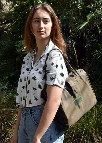 Woman wearing a picnic blanket