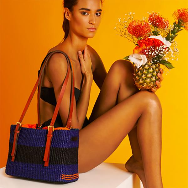 Model sitting with an AAKS Vea Square Shoulder Bag