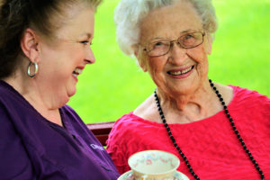 Beaumont home health client and caregiver sharing tea in Top-Rated Home Care Agency