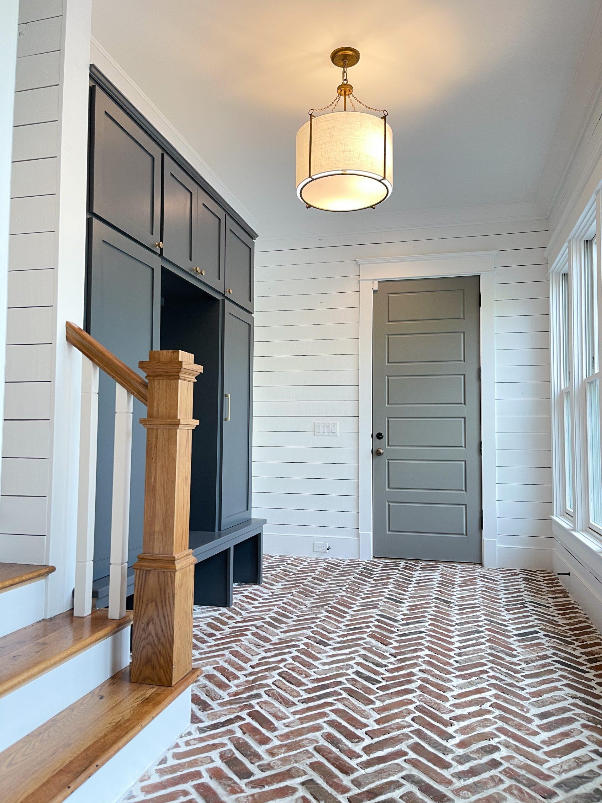 nashville, tn herringbone brick floors navy built-in cabinets white shiplap