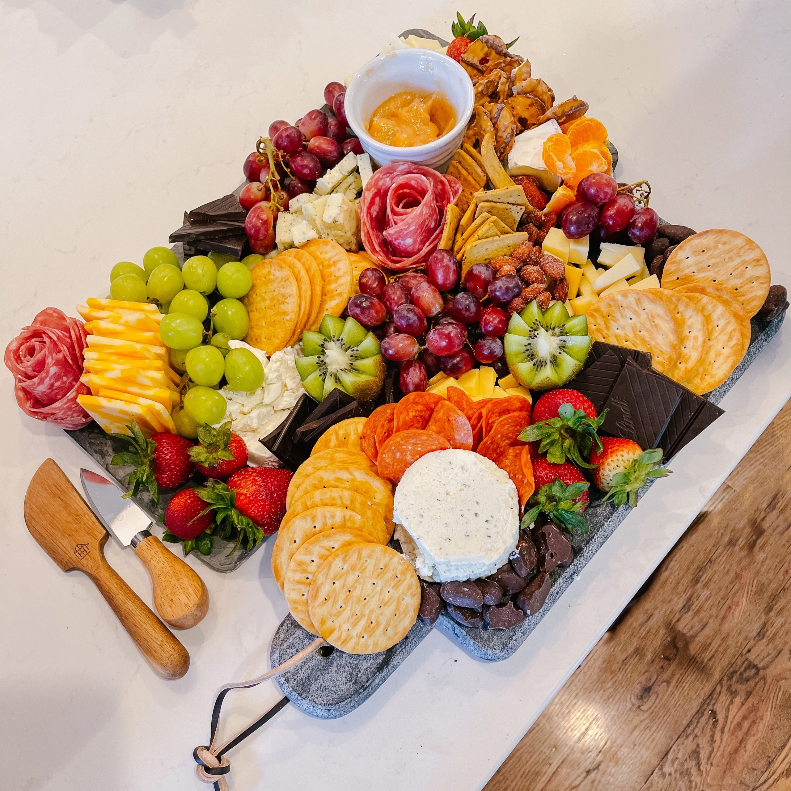 DIY Charcuterie Board Cheese fruit tray on slate cutting board party hosting angela lanter