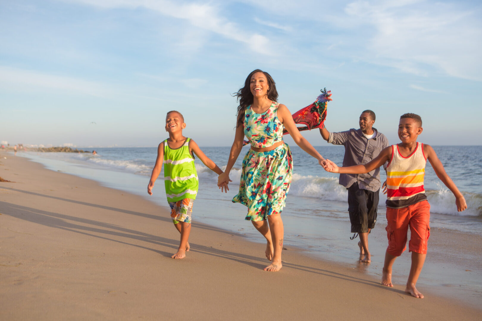 Children,And,Their,Parents,With,Kite,At,The,Beach,Walking