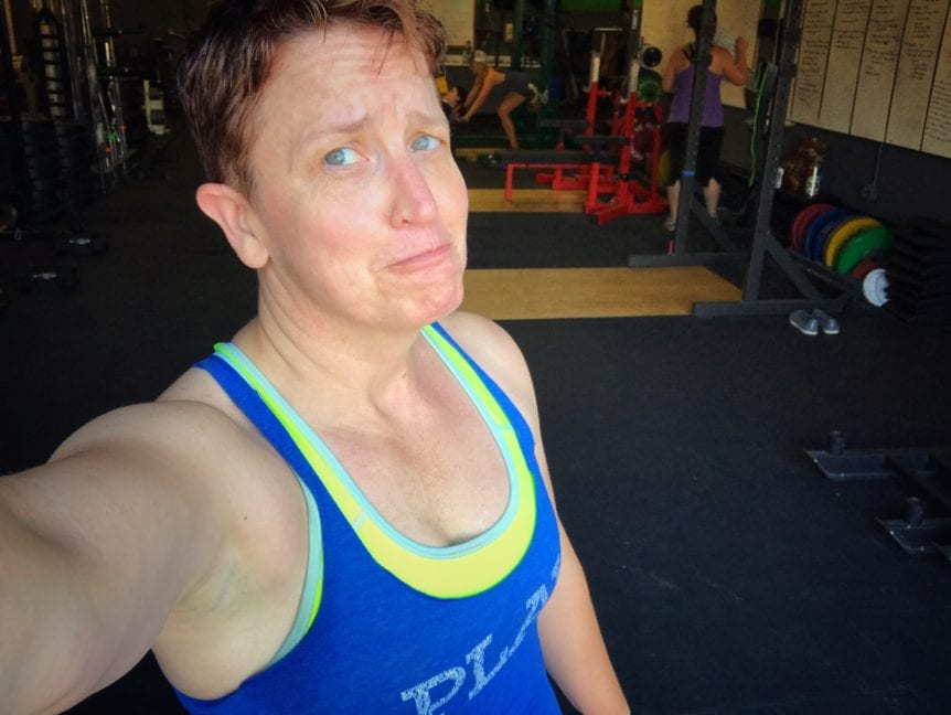 woman with muscles in tank top