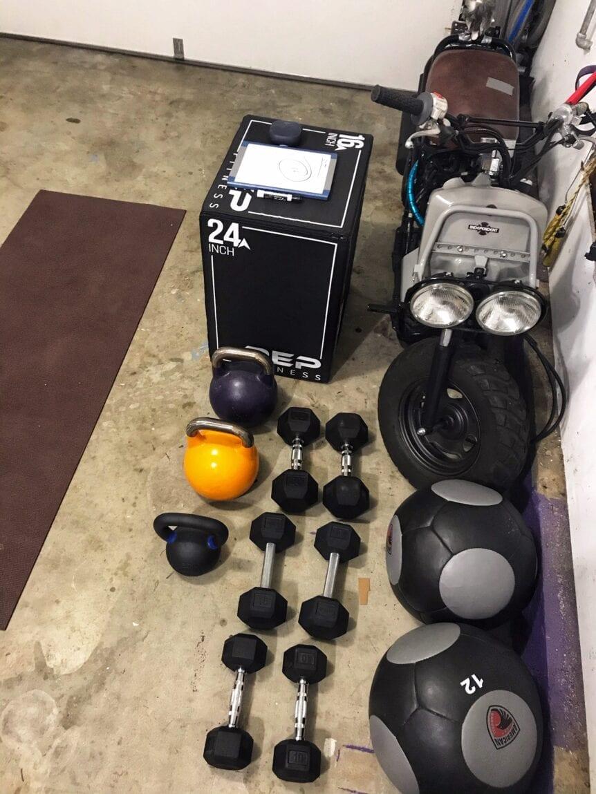 kettlebells and dumbbells in a garage