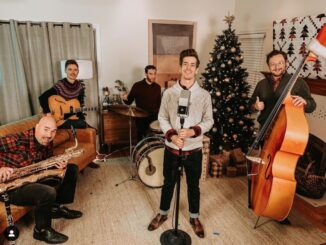 Drew Angus with the band release A Snow Globe Christmas
