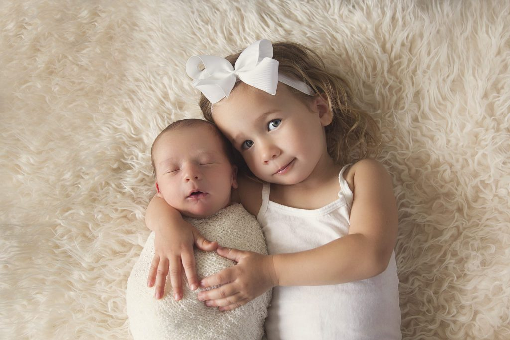 sibling and baby