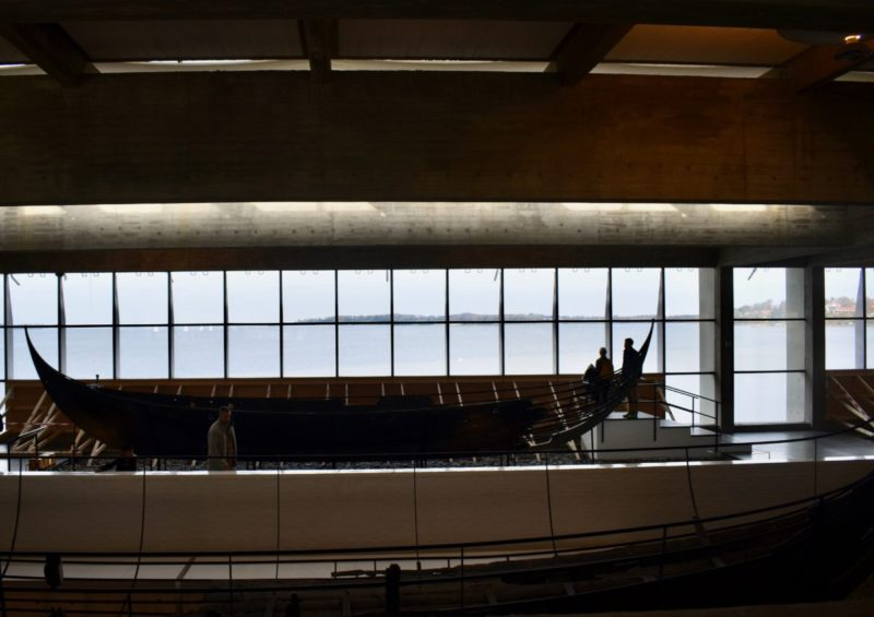 RECONSTRUCTED VIKING LONGBOAT WITH DANISH COAST IN THE BACKGROUND