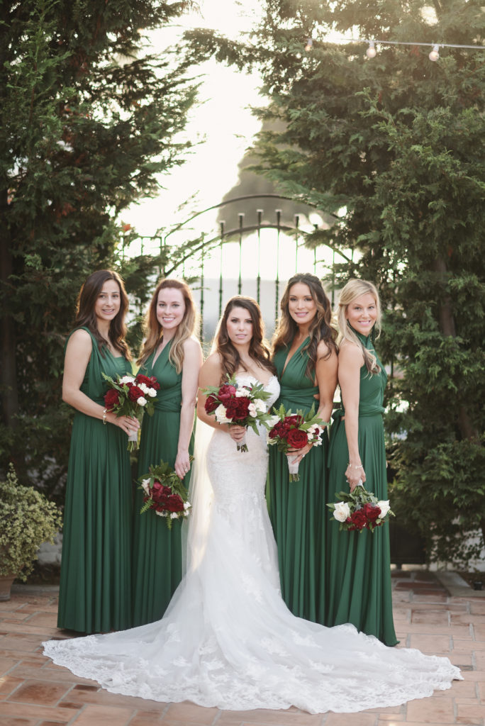bride and bridesmaids, red bouquet, green bridesmaid dresses