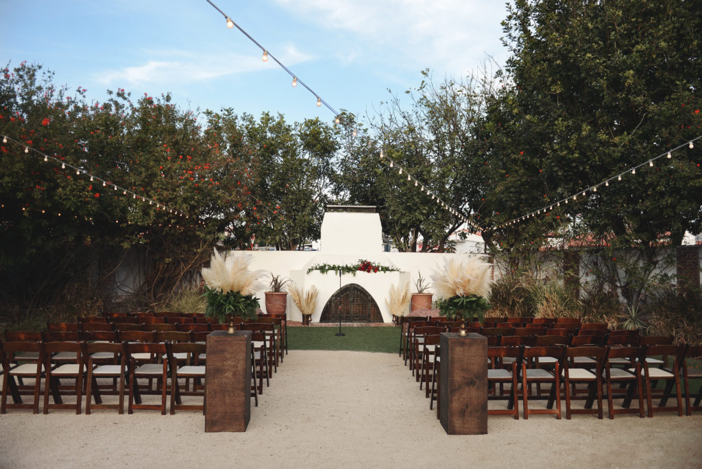 fireplace wedding ceremont, pampas grass arrangements,