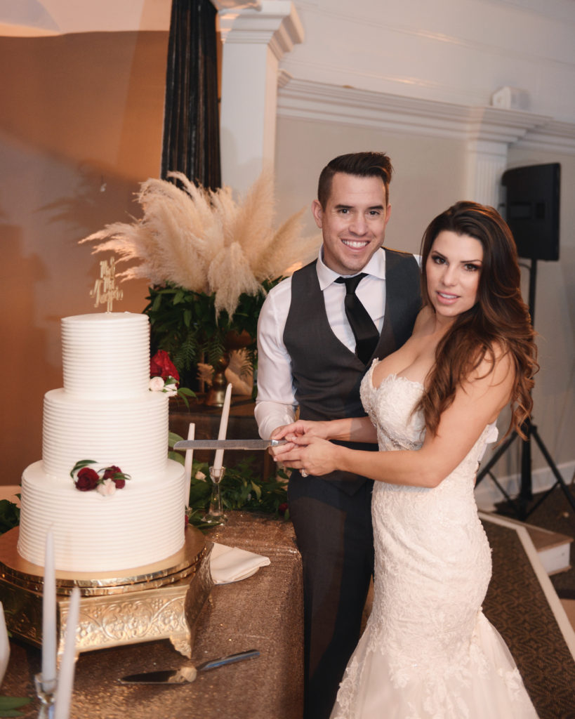 wedding cake cutting, pampas grass centerpieces