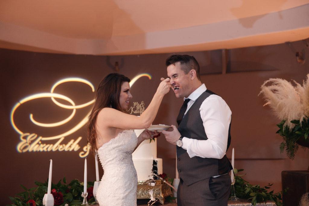 wedding cake cutting, beide and groom eating cake