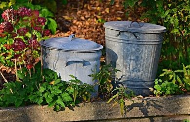 two metal trash cans