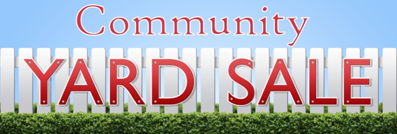 Yard Sale sign on white fence and blue sky.