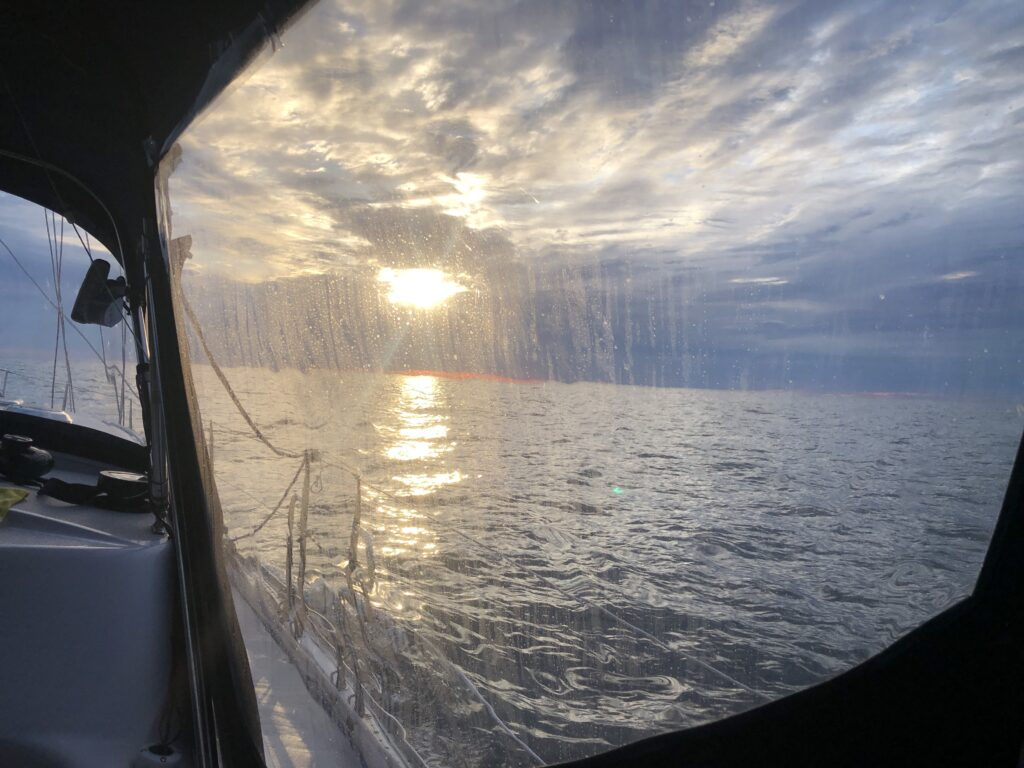 A view of the ocean from within an enclosed cockpit