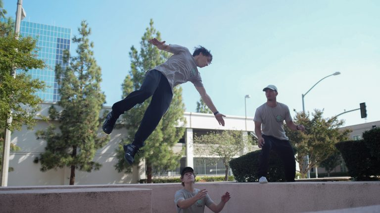 Teen parkour for all ages in the park pk