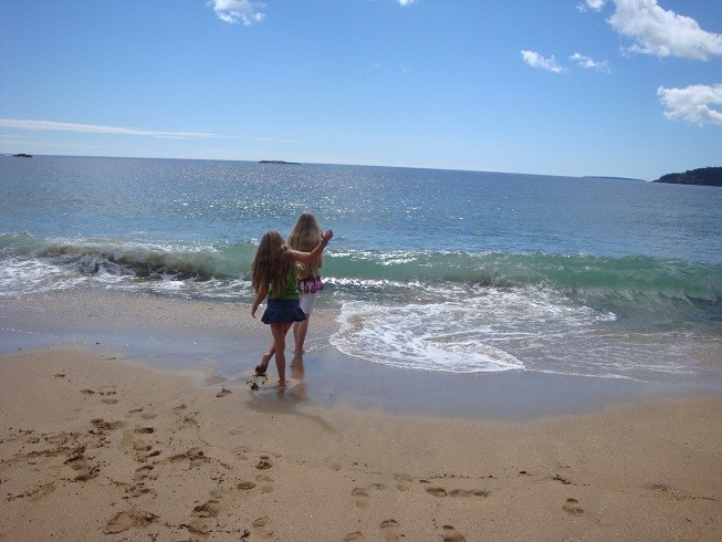 Kids play in the Atlantic, warmer then the Pacific