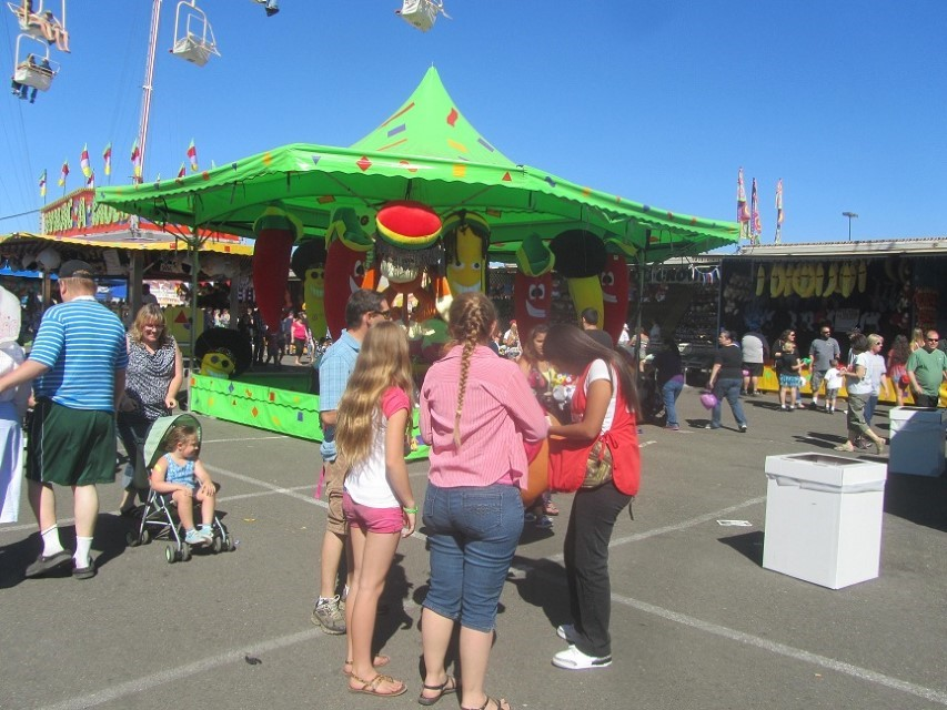 Mike is buying the girls tickets to ride the carnivore rides. I say carnivore, because I saw the ticket prices.