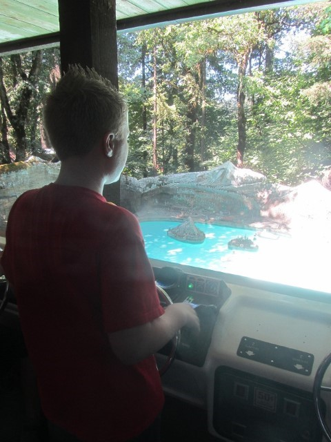 Moving away from guns and ammo, to safer topics, such as boating. Seth pilots his tug boat all around the pool. This boat driving thing is harder than it looks.
