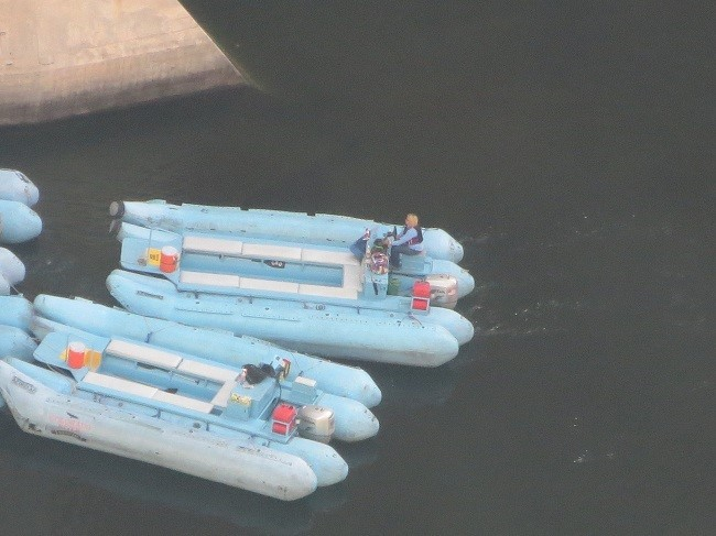 These rafts are moored at the Glen Canyon Dam.  They will take you from here to Lee's Ferry via Horseshoe Bend. Way out of our budget, but they get great reviews. Raft Trip
